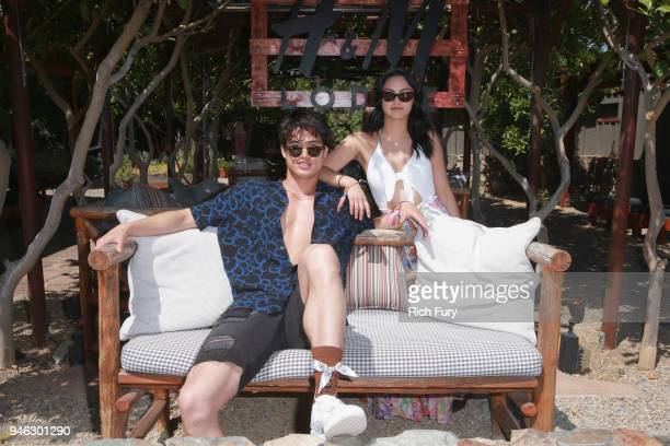 Charles Melton and Camila Mendes poolside with HM at The Sparrows Lodge on April 14 2018 in Palm Springs California