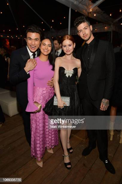 Charles Melton Camila Mendes Madelaine Petsch and Travis Mills attend the 2018 GQ Men of the Year Party at a private residence on December 6 2018 in...
