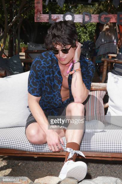 Charles Melton poolside with HM at The Sparrows Lodge on April 14 2018 in Palm Springs California