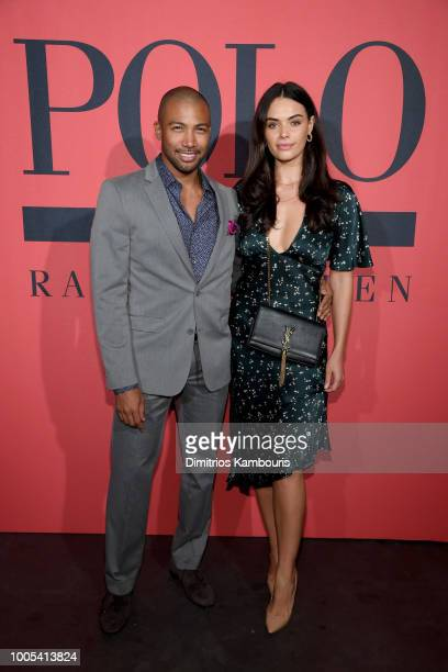 Charles Michael Davis and Monika Clark attend the Polo Red Rush Launch Party with Ansel Elgort at Classic Car Club Manhattan on July 25 2018 in New...