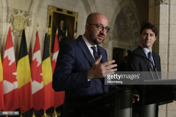 Charles Michel Belgium's prime minister left speaks while Justin Trudeau Canada's prime minister listens during a joint press conference in Ottawa...