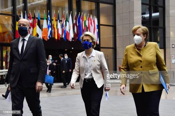 Charles Michel, president of the European Council, left, Ursula von der Leyen, president of the European Commission, center, and Angela Merkel,...