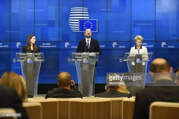 Charles Michel president of the European Union center speaks flanked by Sanna Marin Finland's prime minister left and Ursula von der Leyen president...