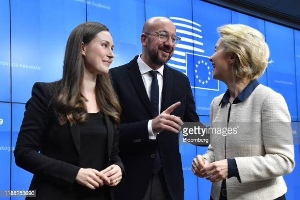Charles Michel president of the European Union center speaks with Ursula von der Leyen president of the European Commission right and Sanna Marin...