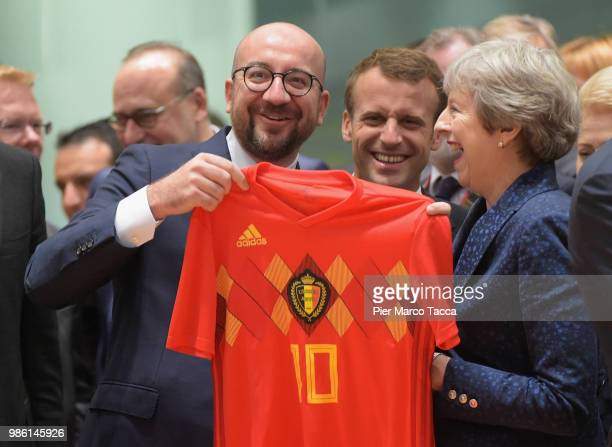 Charles Michel, Prime Minister of Belgium shows the jersey of Belgium football team to Theresa May, Prime Minister of United Kingdom during the EU...