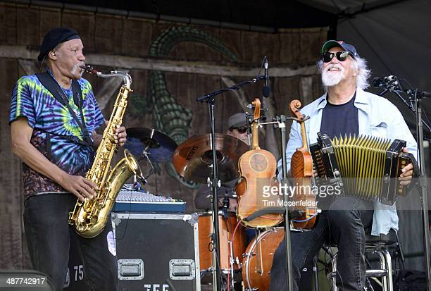 Charles Neville and Michael Doucet of BeauSoleil perform during Day 4 of the 2014 New Orleans Jazz & Heritage Festival at Fair Grounds Race Course on...