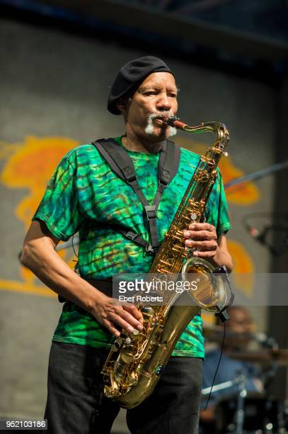 Charles Neville performs with Aaron Neville at the New Orleans Jazz and Heritage Festival at the Fair Grounds Race Course in New Orleans, Louisiana...