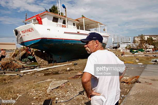Charles Nicholson looks for his belongings near where his trailer home which was swept away by Hurricane Ike once stood September 15 2008 in...