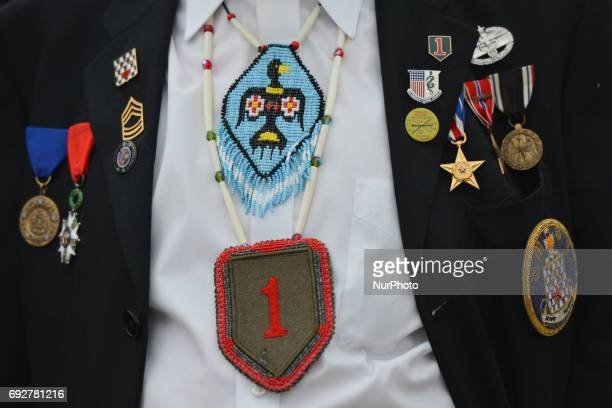 Charles Norman Shay , a Native American, a Penobscot tribal elder and a veteran-soldier from WWII, returns to Omaha beach for the 73rd anniversary of...