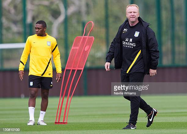 Charles N'Zogbia and Alex McLeish manager of Aston Villa train at the Bodymoor Heath training ground on August 11 2011 in Birmingham England