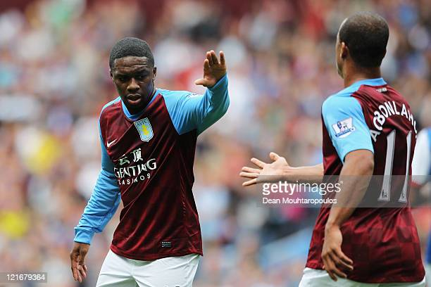 Charles N'Zogbia congratulates team mate Gabriel Agbonlahor of Aston Villa after he sets up the second goal for Emile Heskey during the Barclays...