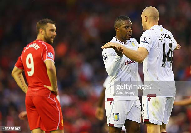 Charles N'Zogbia of Aston Villa celebrates victory with Philippe Senderos as Rickie Lambert of Liverpool looks dejected after the Barclays Premier...
