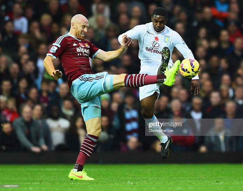 Charles N'Zogbia of Aston Villa challenges James Collins of West Ham United during the Barclays Premier League match between West Ham United and Aston Villa at Boleyn Ground on November 8, 2014 in London, England.