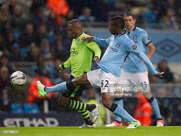 Charles N'Zogbia of Aston Villa is challenged by Abdul Razak of Manchester City during the Capital One Cup match between Manchester City and Aston...