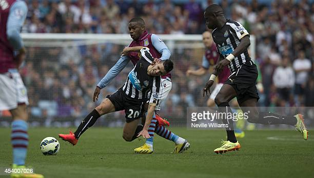 Charles N'Zogbia of Aston Villa is challenged by Remy Cabella of Newcastle United during the Barclays Premier League match between Aston Villa and...