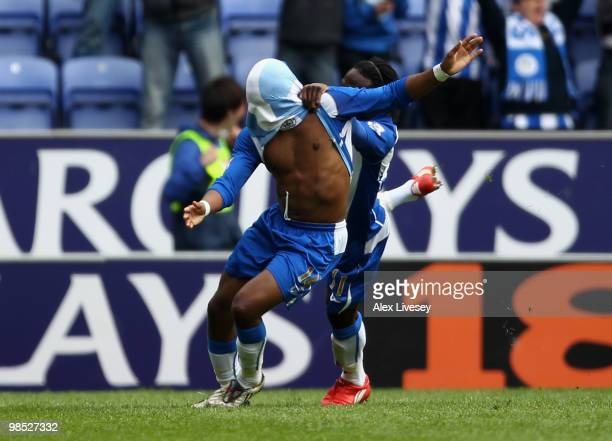 Charles N'Zogbia of Wigan Athletic celebrates with Victor Moses after scoring the winning goal during the Barclays Premier League match between Wigan...
