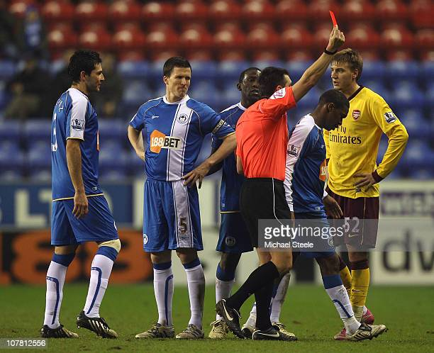 Charles N'Zogbia of Wigan Athletic is sent off by referee Lee Probert during the Barclays Premier League match between Wigan Athletic and Arsenal at...