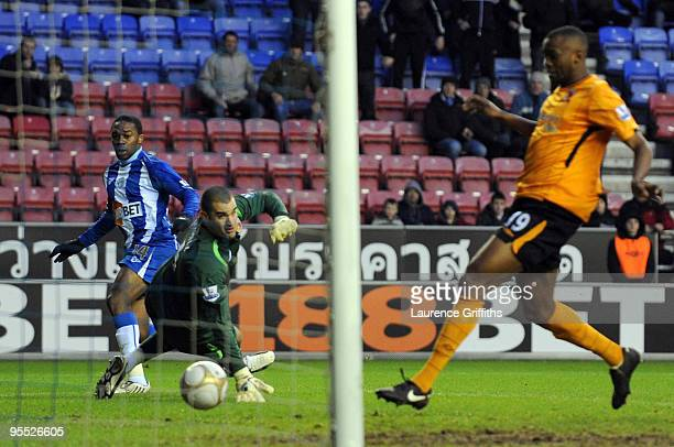Charles N'Zogbia of Wigan scores the equaliser past Boaz Myhill of Hull during the The FA Cup sponsored by EON Third Round match between Wigan...