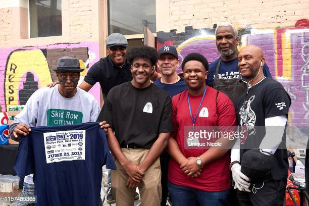 """Charles Oakley and foundation volunteers attend The Help Give Care Foundation and the Charles Oakley Foundation host """"Homeless But Human"""" Pop-up..."""