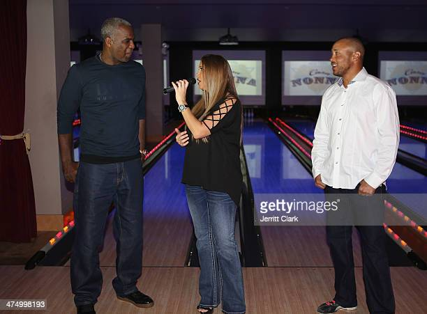 Charles Oakley and John Starks look on as Samantha Cole sings Happy Birthday to Charles Oakley for his 50th Birthday during the 2014 John Starks...