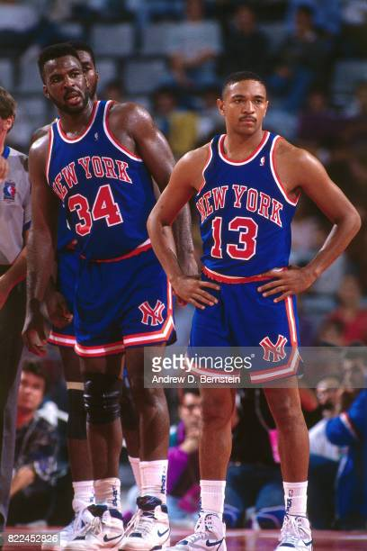 Charles Oakley and Mark Jackson of the New York Knicks stand on the court during the 1990 McDonald's Open against Scavolini Pesaro at Palau Sant...