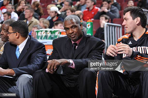 Charles Oakley assistant coach of the Charlotte Bobcats sits courtside against the Philadelphia 76ers during the game on January 17 2011 at the Wells...