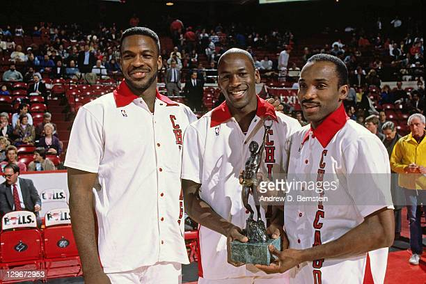Charles Oakley, Michael Jordan and Rory Sparrow of the Chicago Bulls pose for a photo after winning an award circa 1987. NOTE TO USER: User expressly...