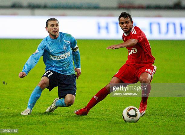 Charles of FC Lokomotiv Moscow battles for the ball with Ruslan Adzhindzhal of FC Krylia Sovetov Samara during the Russian Football League...