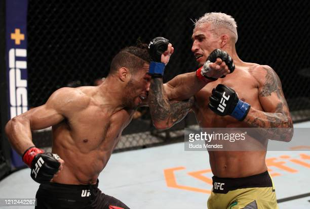 Charles Oliveira of Brazil and Kevin Lee trade punches in their lightweight fight during the UFC Fight Night event on March 14 2020 in Brasilia Brazil