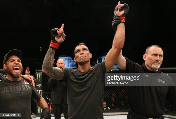 Charles Oliveira of Brazil celebrates after his TKO victory over Nik Lentz in their lightweight bout during the UFC Fight Night event at Blue Cross...