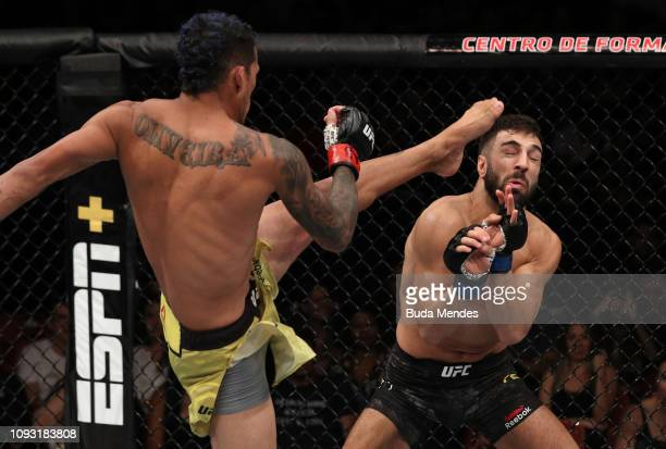 Charles Oliveira of Brazil kicks David Teymur of Sweden in their lightweight fight during the UFC Fight Night event at CFO Centro de Formacao...