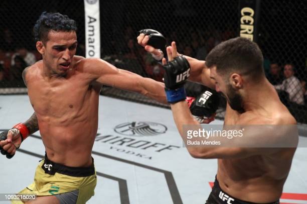 Charles Oliveira of Brazil lands a spinning back fist against David Teymur of Sweden in their lightweight fight during the UFC Fight Night event at...
