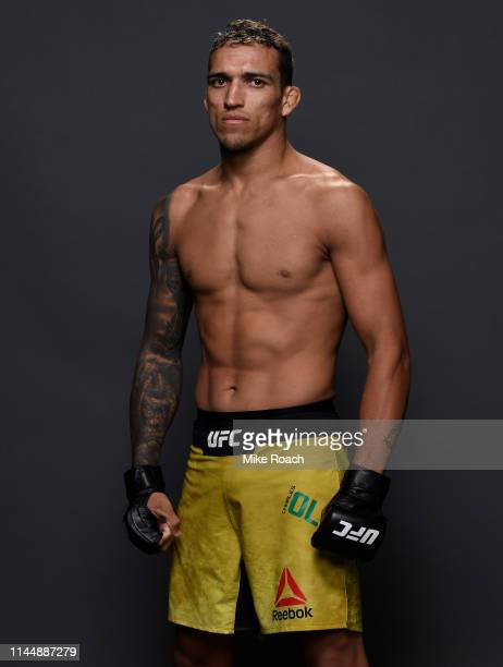 Charles Oliveira of Brazil poses for a portrait backstage after his victory over Nik Lentz during the UFC Fight Night event at Blue Cross Arena on...