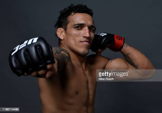 Charles Oliveira of Brazil poses for a portrait backstage after his victory during the UFC Fight Night event at Ibirapuera Gymnasium on November 16...