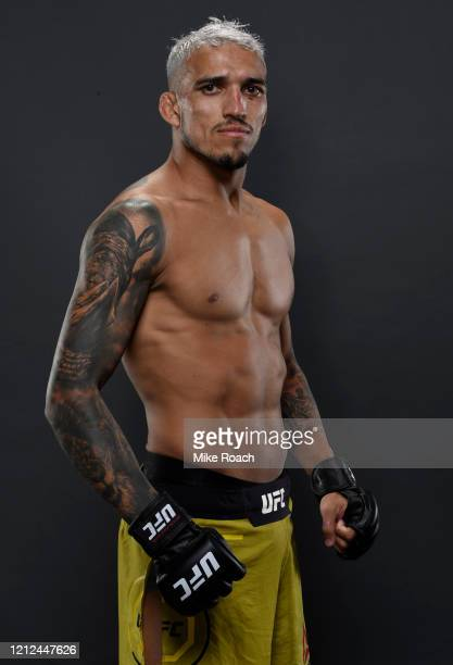 Charles Oliveira of Brazil poses for a portrait backstage after his victory during the UFC Fight Night event on March 14, 2020 in Brasilia, Brazil.