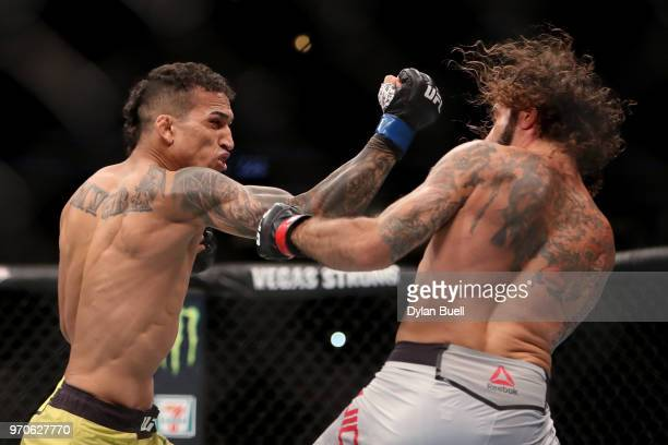 Charles Oliveira of Brazil punches Clay Guida in the first round in their lightweight bout during the UFC 225 Whittaker v Romero 2 event at the...