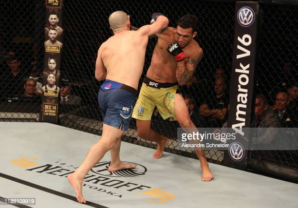 Charles Oliveira of Brazil punches Jared Gordon in their lightweight fight during the UFC Fight Night event at Ibirapuera Gymnasium on November 16...