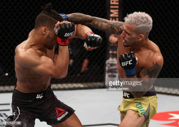 Charles Oliveira of Brazil punches Kevin Lee in their lightweight fight during the UFC Fight Night event on March 14 2020 in Brasilia Brazil