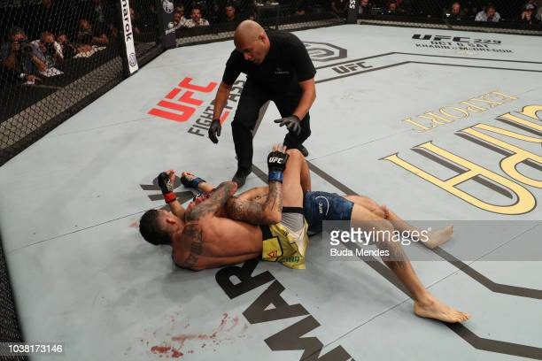 Charles Oliveira of Brazil submits Christos Giagos in their lightweight bout during the UFC Fight Night event at Ibirapuera Gymnasium on September 22...