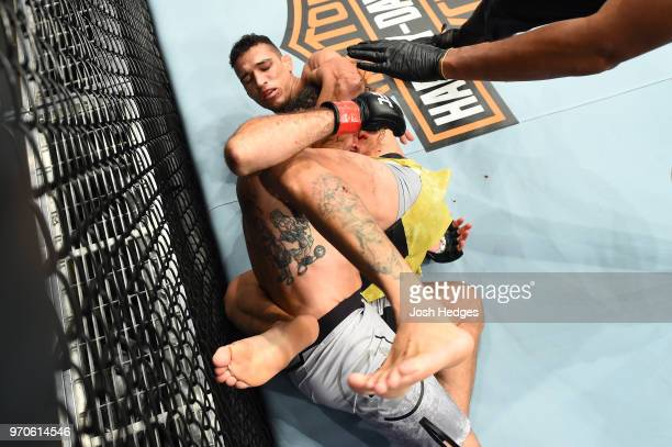 Charles Oliveira of Brazil submits Clay Guida in their lightweight fight during the UFC 225 event at the United Center on June 9 2018 in Chicago...