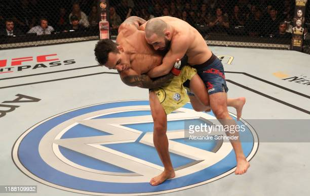Charles Oliveira of Brazil takes down Jared Gordon in their lightweight fight during the UFC Fight Night event at Ibirapuera Gymnasium on November 16...