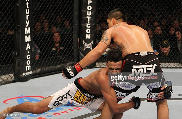 Charles Oliveira shoots for a takedown against Efrain Escudero at UFC Fight Night at the Frank Irwin Center on September 15, 2010 in Austin, Texas.