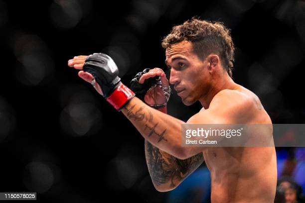 Charles Oliveira stands in the octagon during a lightweight bout against Nik Lentz at Blue Cross Arena on May 18 2019 in Rochester New York Oliveira...