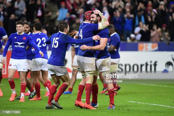 Charles OLLIVON of France celebrates with Bernard LE ROUX of France and Anthony BOUTHIER of France after their side wins the Six Nations match...