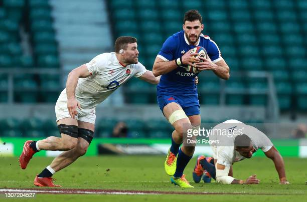 Charles Ollivon of France goes past Mark Wilson during the Guinness Six Nations match between England and France at Twickenham Stadium on March 13,...