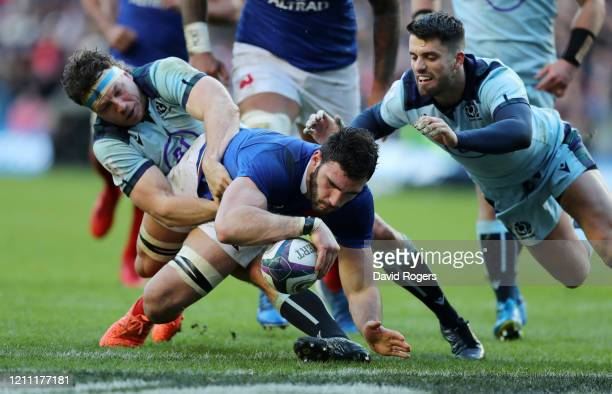 Charles Ollivon of France scores his sides second try under pressure from Adam Hastings of Scotland and Hamish Watson of Scotland during the 2020...