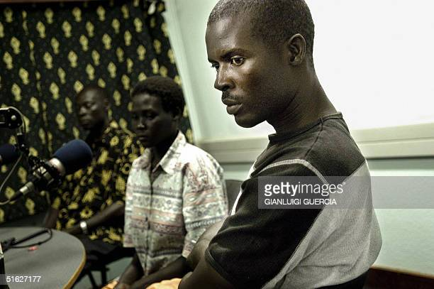 Charles Otin former lieutenant colonel of the LRA waits 29 October 2004 to speak on the microphone of Mega Radio station in Gulu Town Northern Uganda...