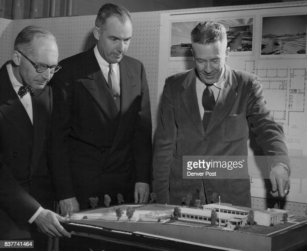 Charles Overholt Denver architect and a member of the American Institute of Architects schools committee points to a landscape feature in a model of...