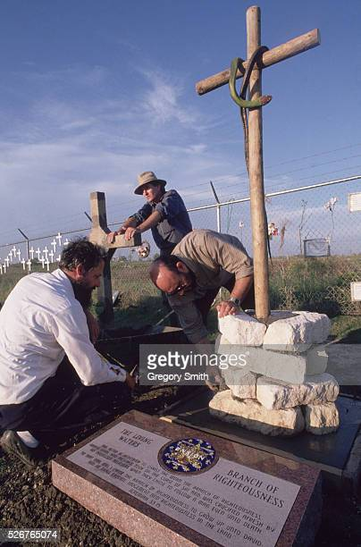 Charles Pace and other members of the Branch Davidians erect a memorial to those lost at the Mount Carmel compound during the 1993 raid by the Bureau...