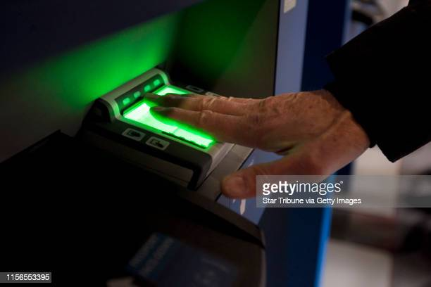 Charles Phipps of Baltimore Maryland scanned his finger prints as he used the new Global Entry System to clear custom at the Minneapolis Airport...